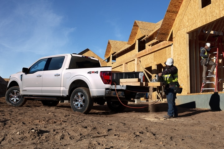 Construction workers working around a 2021 Ford F 1 50