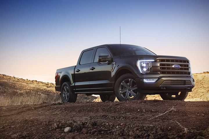 A 2021 Ford F 1 50 lariat sport parked on a hill