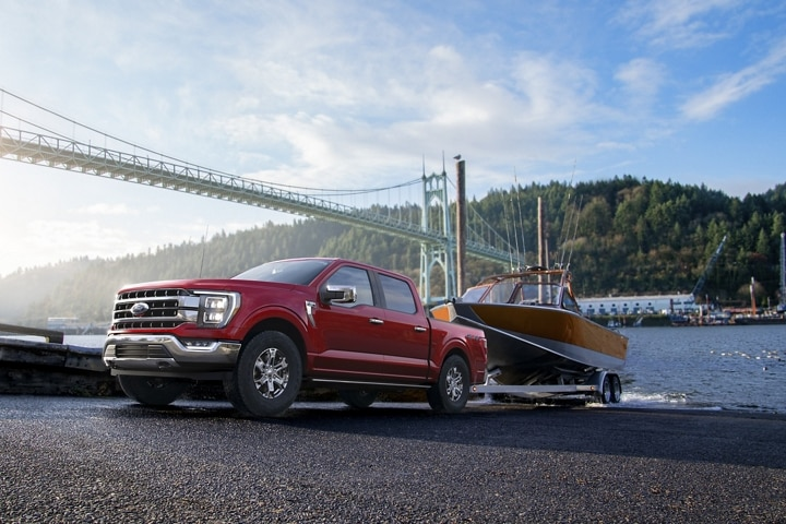 A 2021 Ford F 1 50 backing up a boat into water